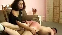 Brunette milf in jewel spanking