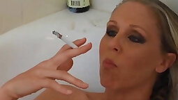 Busty Blonde MILF Smokes Like Bobby Hart