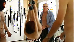 Bright beauteous redhead in bondage receives a gangbanged