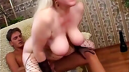 Blonde granny making love and bating with a big long dildo