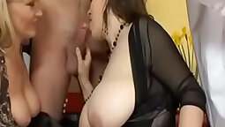 Babe with big tits giving head